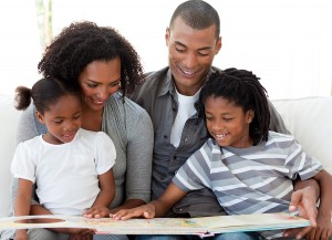 bigstock-Afro-american-Family-Reading-A-6414615